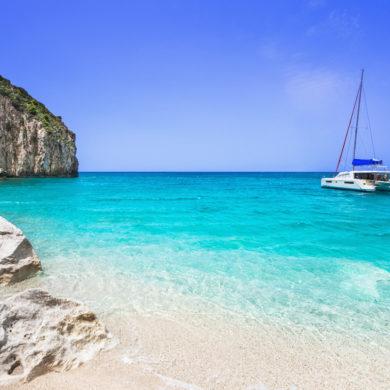 Beautiful lagoon with sailing boat and beach, Lefkada island, Greece